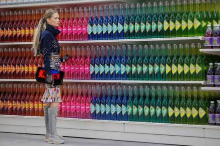 """A model presents a creation by German designer Karl Lagerfeld as part of his Fall/Winter 2014-2015 women's ready-to-wear collection for French fashion house Chanel at the Grand Palais transformed into a """"Chanel Shopping Center"""" during Paris Fashion Week March 4, 2014. REUTERS/Stephane Mahe (FRANCE - Tags: FASHION)"""